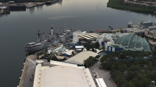 DX0003_230_033 - 5.7K stock footage aerial video of circling a warship museum and aquarium in Tampa, Florida