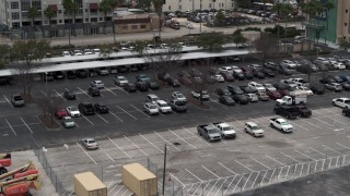 DX0003_230_035 - 5.7K stock footage aerial video of descending by a parking lot in Tampa, Florida