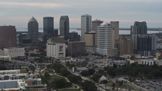 DX0003_230_046 - 5.7K stock footage aerial video descend while focused on tall skyscrapers in the city's skyline, Downtown Tampa, Florida