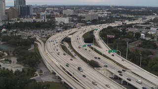 DX0003_231_003 - 5.7K stock footage aerial video flyby and away from freeway traffic in Tampa, Florida