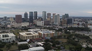 DX0003_231_006 - 5.7K stock footage aerial video a wide view of passing by skyscrapers in the city's skyline, Downtown Tampa, Florida