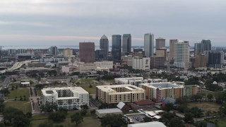 DX0003_231_008 - 5.7K stock footage aerial video orbit apartment buildings, reveal skyscrapers in the city's skyline, Downtown Tampa, Florida