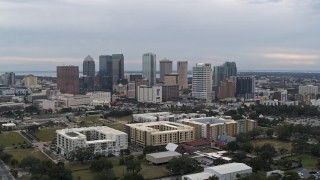 DX0003_231_009 - 5.7K stock footage aerial video orbit apartment buildings with city's skyline in background, Downtown Tampa, Florida