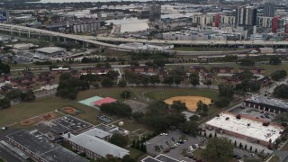 DX0003_231_013 - 5.7K stock footage aerial video of apartment buildings by elementary school, Tampa, Florida