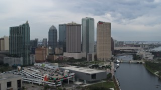 DX0003_231_017 - 5.7K stock footage aerial video reverse view of skyscrapers by the river during descent, Downtown Tampa, Florida