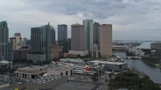 DX0003_231_018 - 5.7K stock footage aerial video ascend and orbit skyscrapers by the river, Downtown Tampa, Florida