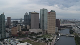 DX0003_231_019 - 5.7K stock footage aerial video of orbiting skyscrapers by the river, Downtown Tampa, Florida