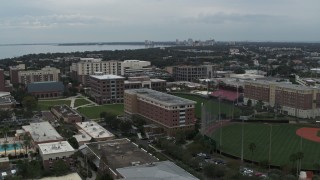 DX0003_231_022 - 5.7K stock footage aerial video descend and fly away from the University of Tampa campus, Florida