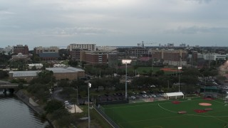 DX0003_231_023 - 5.7K stock footage aerial video approach and ascend toward the University of Tampa campus, Florida
