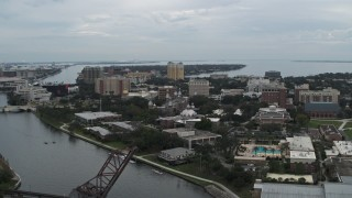 DX0003_231_024 - 5.7K stock footage aerial video reverse view of the University of Tampa campus from the river, Florida