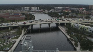 DX0003_231_027 - 5.7K stock footage aerial video heavy traffic on a bridge spanning the river in Tampa, Florida