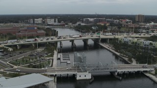 DX0003_231_028 - 5.7K stock footage aerial video orbit traffic on a bridge spanning the river in Tampa, Florida