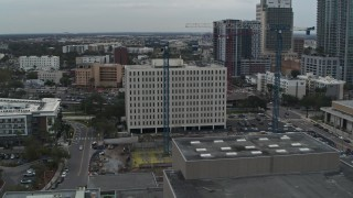 DX0003_231_031 - 5.7K stock footage aerial video of orbiting the Times Building in Downtown Tampa, Florida