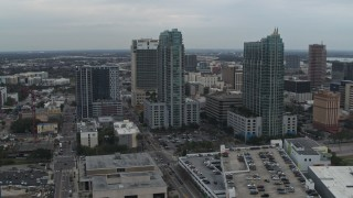 DX0003_231_036 - 5.7K stock footage aerial video of a reverse view of a pair of high-rise buildings in Downtown Tampa, Florida