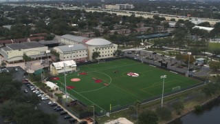 DX0003_231_039 - 5.7K stock footage aerial video ascend and orbit the Tampa Preparatory School campus, Tampa, Florida