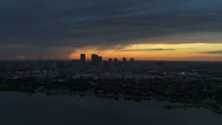 DX0003_231_042 - 5.7K stock footage aerial video of the distant city skyline of Downtown Tampa, Florida at sunset