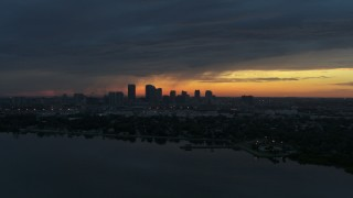 DX0003_231_044 - 5.7K stock footage aerial video of the distant city skyline of Downtown Tampa, Florida at sunset