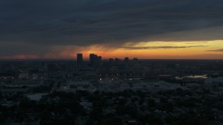 DX0003_231_048 - 5.7K stock footage aerial video a reverse view of the Downtown Tampa skyline at sunset, Florida