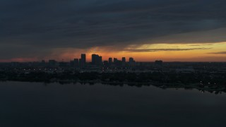 DX0003_231_050 - 5.7K stock footage aerial video a view of the Downtown Tampa skyline from the bay at sunset, Florida