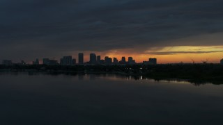 DX0003_231_052 - 5.7K stock footage aerial video a view of the Downtown Tampa skyline while flying low over the bay at sunset, Florida