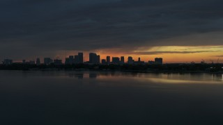 DX0003_231_053 - 5.7K stock footage aerial video fly toward Downtown Tampa skyline from the bay at sunset, Florida