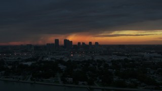 DX0003_231_055 - 5.7K stock footage aerial video slowly fly away from Downtown Tampa skyline at sunset, Florida