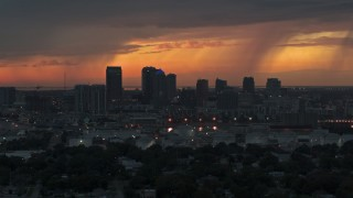 DX0003_232_002 - 5.7K stock footage aerial video slowly passing by the Downtown Tampa skyline at twilight, Florida