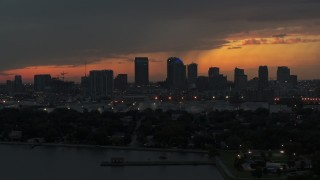 DX0003_232_007 - 5.7K stock footage aerial video fly past the Downtown Tampa skyline at twilight, Florida
