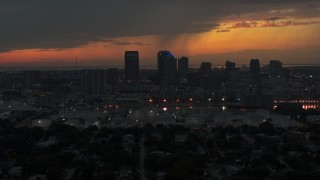 DX0003_232_008 - 5.7K stock footage aerial video of passing the Downtown Tampa skyline at twilight, Florida