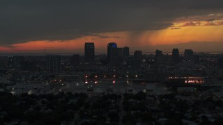 DX0003_232_009 - 5.7K stock footage aerial video of slowly flying away from the Downtown Tampa skyline at twilight, Florida