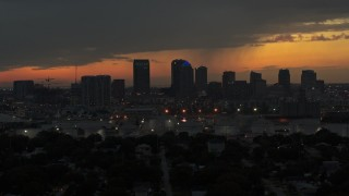 DX0003_232_012 - 5.7K stock footage aerial video a reverse view of the Downtown Tampa skyline at twilight, Florida