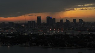 DX0003_232_014 - 5.7K stock footage aerial video flying by skyscrapers in the Downtown Tampa skyline at twilight, Florida