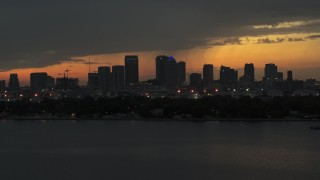 DX0003_232_015 - 5.7K stock footage aerial video passing by skyscrapers in the Downtown Tampa skyline at twilight, Florida