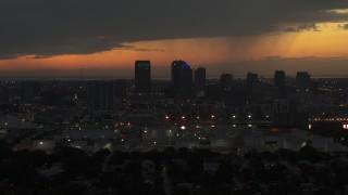 DX0003_232_017 - 5.7K stock footage aerial video slowly fly away from skyscrapers in the Downtown Tampa skyline at twilight, Florida