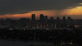 DX0003_232_018 - 5.7K stock footage aerial video descend past skyscrapers in the Downtown Tampa skyline at twilight, Florida