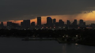 DX0003_232_019 - 5.7K stock footage aerial video of passing skyscrapers in the Downtown Tampa skyline at twilight, Florida