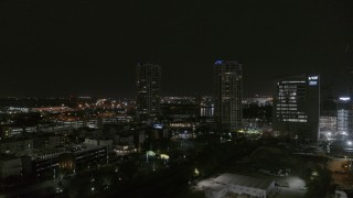 DX0003_232_023 - 5.7K stock footage aerial video of approaching office buildings at night, Downtown Tampa, Florida