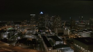 DX0003_232_026 - 5.7K stock footage aerial video of circling skyscrapers at night in Downtown Tampa, Florida
