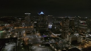 DX0003_232_035 - 5.7K stock footage aerial video of slowly flying away from skyscrapers at nighttime in Downtown Tampa, Florida