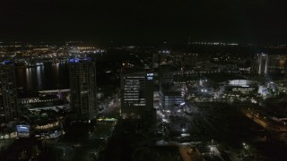 DX0003_232_036 - 5.7K stock footage aerial video of slowly orbiting college at nighttime in Downtown Tampa, Florida