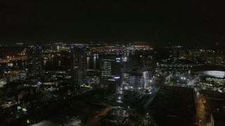 DX0003_232_037 - 5.7K stock footage aerial video of orbiting medical college at nighttime in Downtown Tampa, Florida