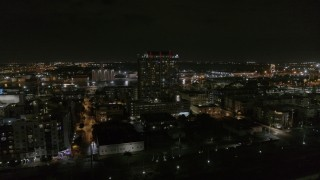 DX0003_232_040 - 5.7K stock footage aerial video of an orbit of an apartment building at night in Downtown Tampa, Florida