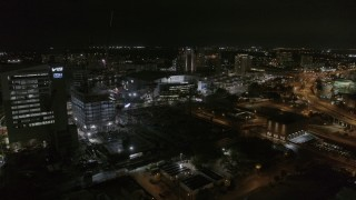 DX0003_232_043 - 5.7K stock footage aerial video ascend away from Amalie Arena at night in Downtown Tampa, Florida