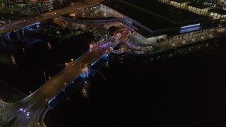 DX0003_232_052 - 5.7K stock footage aerial video police cars on the bridge by convention center at night in Downtown Tampa, Florida