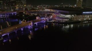 DX0003_232_053 - 5.7K stock footage aerial video police cars on a bridge by convention center at night in Downtown Tampa, Florida