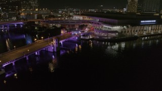 DX0003_232_054 - 5.7K stock footage aerial video orbit police cars on a bridge by convention center at night in Downtown Tampa, Florida
