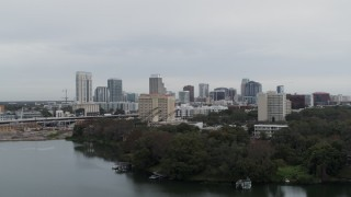 DX0003_233_006 - 5.7K stock footage aerial video descend away from hotel and the city's skyline, Downtown Orlando, Florida