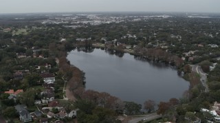 DX0003_233_013 - 5.7K stock footage aerial video ascend away from waterfront homes around Lake Adair, Orlando, Florida