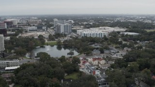 DX0003_233_018 - 5.7K stock footage aerial video of flying past Lake Dot and apartment buildings in Orlando, Florida