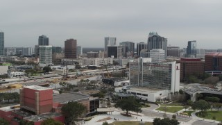DX0003_233_034 - 5.7K stock footage aerial video approach the city's skyline from a nearby hotel, Downtown Orlando, Florida